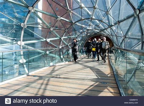 Shoppers walk through glass tunnel connecting Manchester